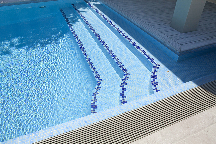 Swimming pool steps ledges crystal pools - Non slip tiles for swimming pools ...